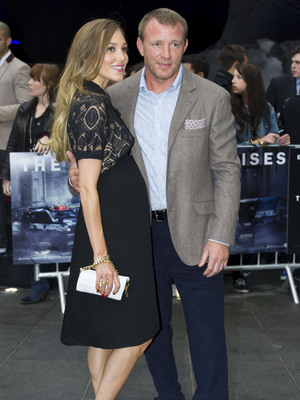 Jacqui Ainsley and Guy Richie at the UK premiere of 'The Dark Knight Rises'