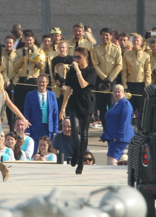 REVEAL USE ONLY: Victoria Beckham doing a warm up performance for the Olympics closing ceremony