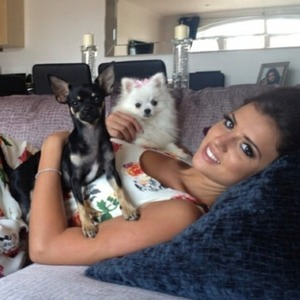 Lucy Mecklenburgh poses with dogs Lola and Bentley