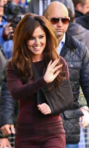 Cheryl Cole, with her arm in a sling following her recent car accident, arriving at the BBC Radio 1 studios