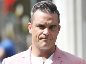 Robbie Williams on the set of his new music video in Spitalfields Market London, England - 17.08.12 Credit: (Mandatory): WENN.com