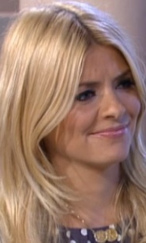 Holly Willoughby stifles a laugh interviewing man with largest penis