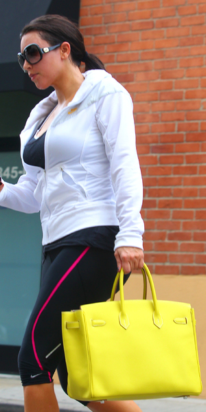 Kim Kardashian  is seen leaving the gym in Studio City carrying a bright yellow Hermes Birkin  handbag Los Angeles, California - 22.06.11 Credit: (Mandatory) WENN.com