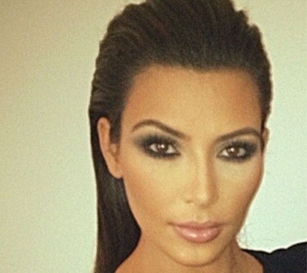 Kim Kardashian with slicked back hair