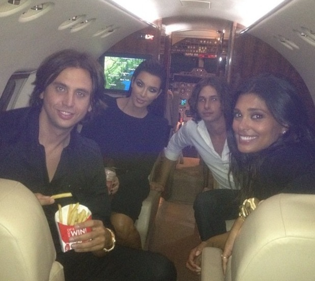 Kim Kardashian and pals on board a private jet as they head to DNC party in North Carolina