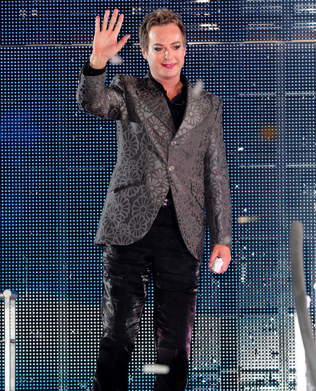 Julian Clary leaves the Celebrity Big Brother House as the winner during the live final at Elstree Studios, Borehamwood. Picture date: Friday September 7, 2012. Photo credit should read: Ian West/PA Wire