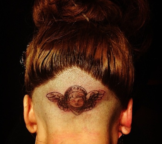 Lady Gaga's shows off the tattoo on the shaved part of her head.