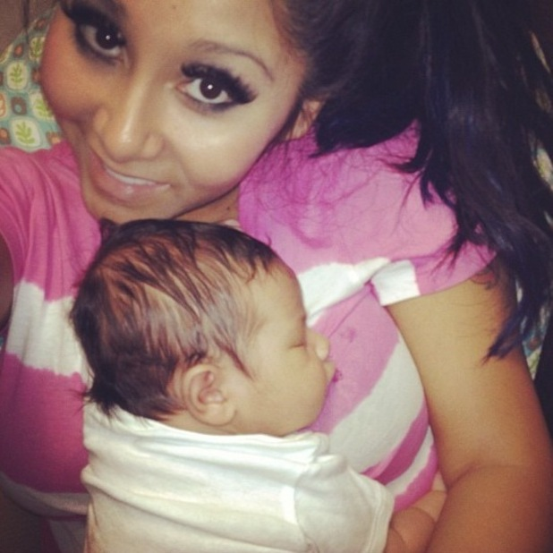 snooki watches jersey shore with baby lorenzo picture