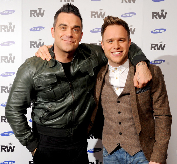 Robbie Williams announces his new European Stadium Tour, supported by Olly Murs and presented in association with Samsung, at the Soho Hotel.in London. Picture date: Monday November 26, 2012. Photo credit should read: Ian West/PA Wire
