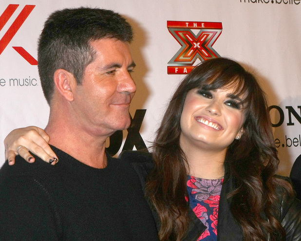 The X Factor 2012 Final Four Party at Rodeo Drive Featuring: Simon Cowell, Demi Lovato Where: Beverly Hills, California, United States When: 06 Dec 2012 Credit: Nikki Nelson / WENN.com