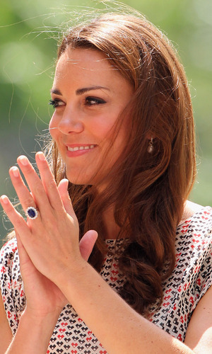 The Duchess of Cambridge during a visit to Queenstown in Singapore, as part of a nine-day tour of the Far East and South Pacific, with the Duke of Cambridge, in honour of the Queen's Diamond Jubilee. Picture date: Wednesday September 12, 2012. See PA story ROYAL Jubilee. Photo credit should read: Chris Jackson/PA Wire