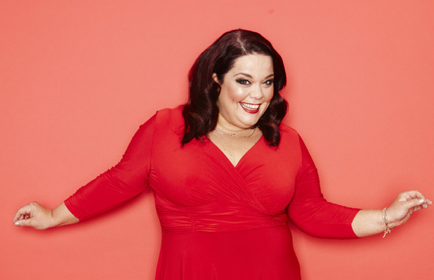Lisa Riley wearing a red dress for Reveal's exclusive photo shoot.