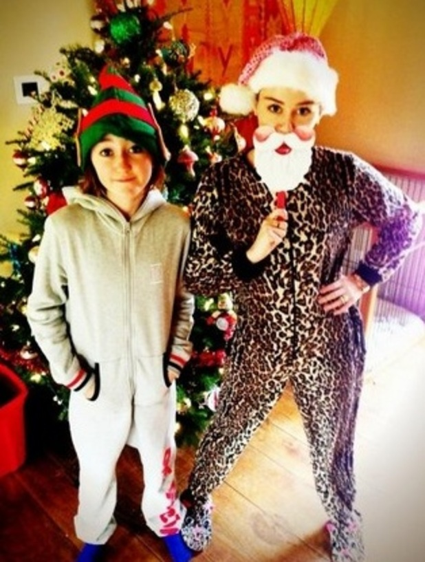 Hot Or Not? Miley Cyrus Rocks A Onesie! photo 1