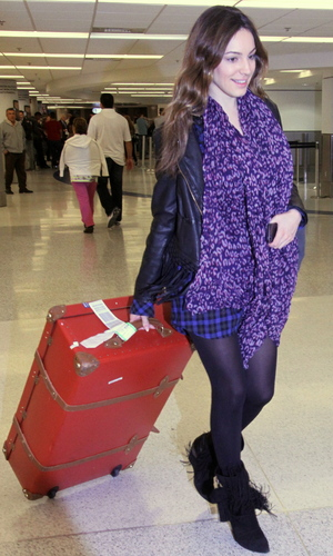 Kelly Brook is all smiles as she arrives at Miami International Airport wearing a purple animal print scarf and leather jacketFeaturing: Kelly Brook Where: Miami, Florida, United States When: 31 Jan 2013 Credit: WENN.com