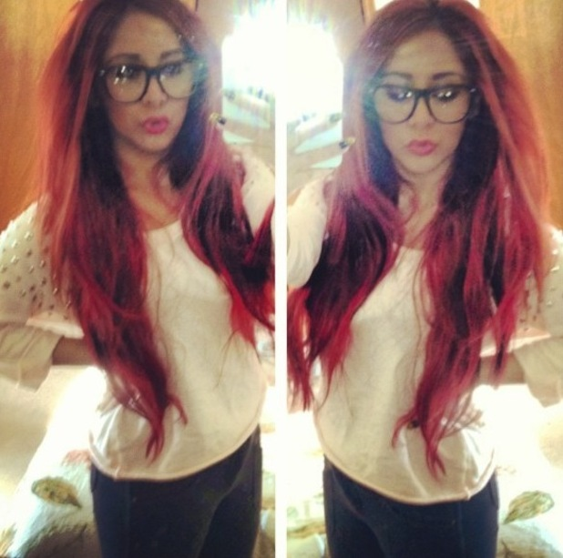 Snooki posts a photograph of her bright red hair