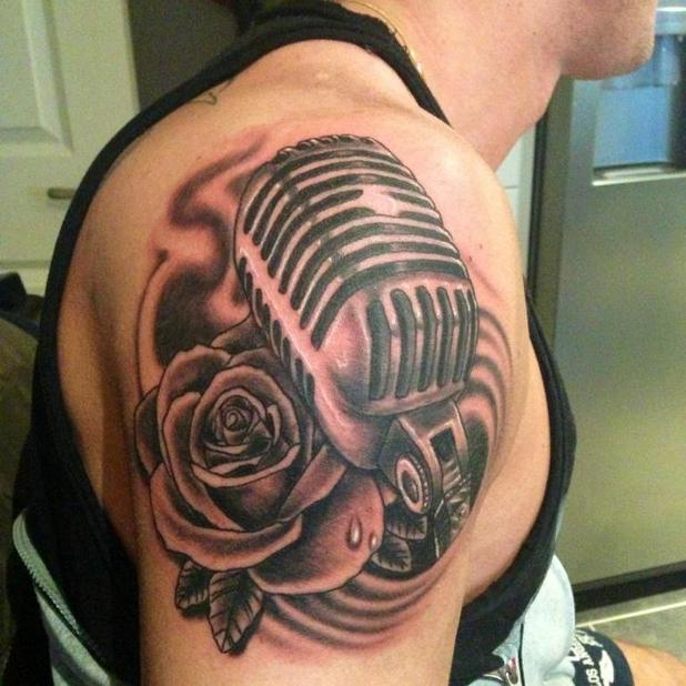 Kirk Norcross debuts new tattoo on bicep of microphone and rose