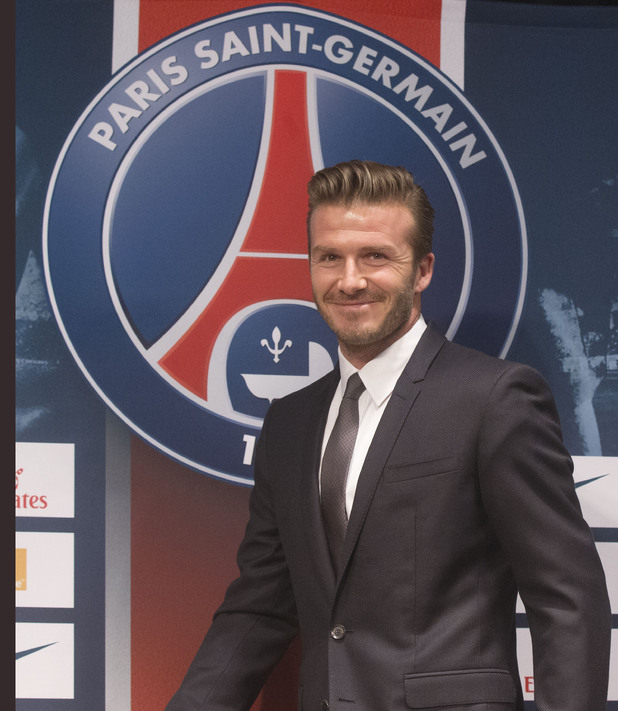 British soccer player David Backham smiles as he arrives at a press conference, in at the Parc des Princes stadium in Paris, Thursday, Jan. 31, 2013. David Beckham will join Paris Saint-Germain on Thursday, opting for a move to France after mulling over lucrative offers from around the world since leaving the Los Angeles Galaxy.(AP Photo/Michel Euler)