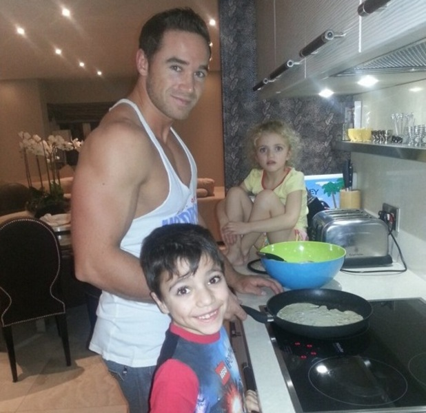 Kieran Hayler poses in the kitchen of Katie Price's house with Junior and Princess - February 2013