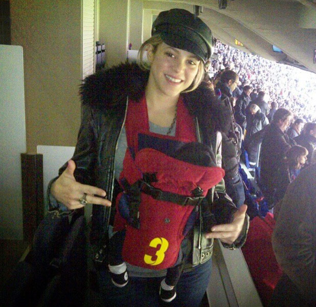 Shakira tweets picture of herself and baby Milan at a Barcelona match.