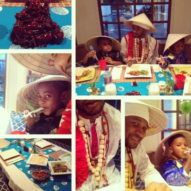 Usher plays fancy dress with his sons at dinner