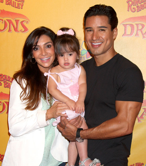 Courtney Mazza, Mario Lopez and their daughter Gia 'Dragons' presented by Ringling Bros. & Barnum & Bailey Circus at Staples Center - Arrivals Los Angeles, California - 12.07.12 Mandatory Credit: Nikki Nelson / WENN.com
