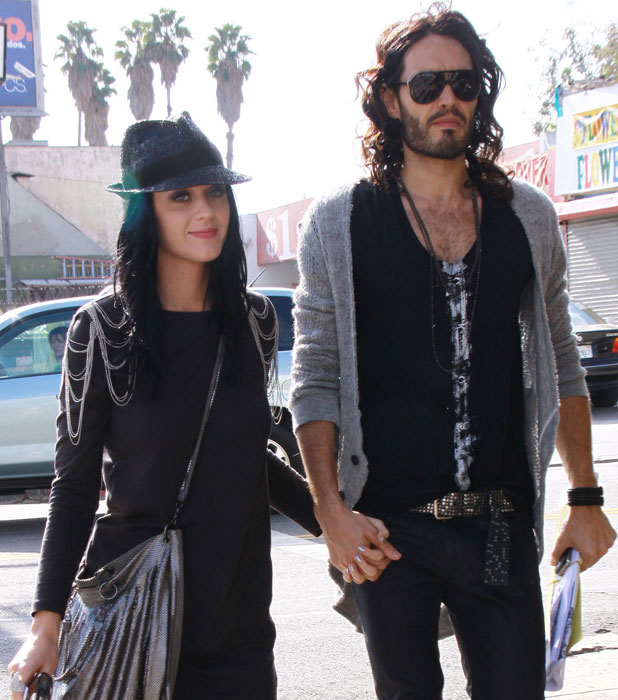Katy Perry and Russell Brand holding hands while walking on Sunset Blvd in West Hollywood. Los Angeles, California, USA - 17.01.10