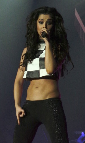 Cheryl Cole performing live as part of Girls Aloud