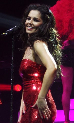 Cheryl Cole performing live as part of Girls Aloud on their world tour