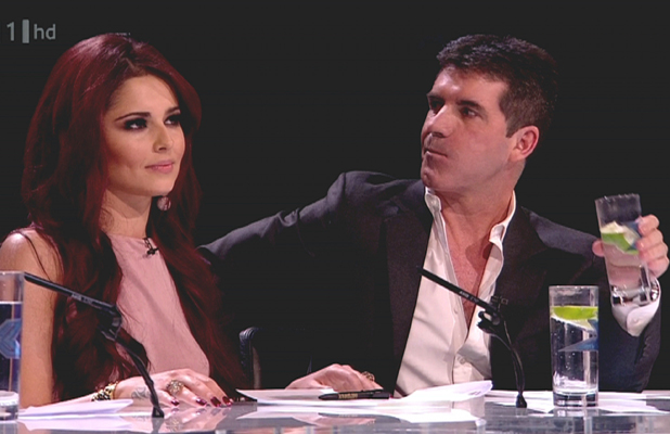 Cheryl Cole and Simon Cowell are the judges on 'The X Factor'. Shown on ITV1. England - 23.10.10 Supplied by WENN.com