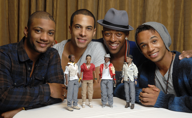JLS pose with JLS dolls