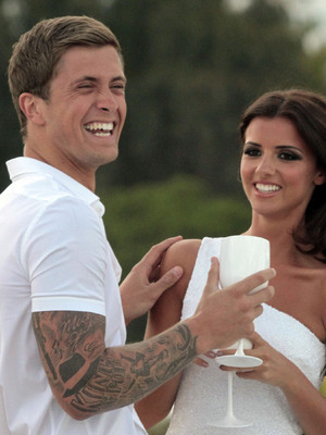 Lucy Mecklenburgh and Dan Osborne drinking  in Marbella and Dan touching Lucy's shoulder, 28th May 2013. REVEAL USE ONLY.