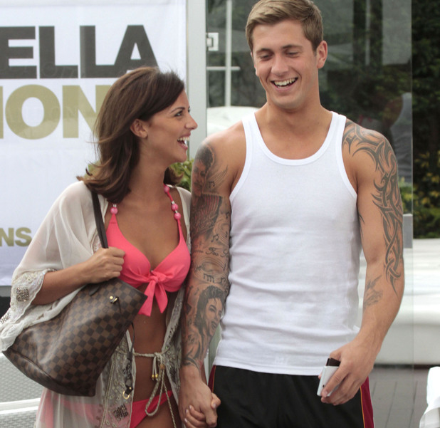 Lucy Mecklenburgh and Dan Osborne holding hands and flirting in Marbella, 28th May 2013. REVEAL USE ONLY.