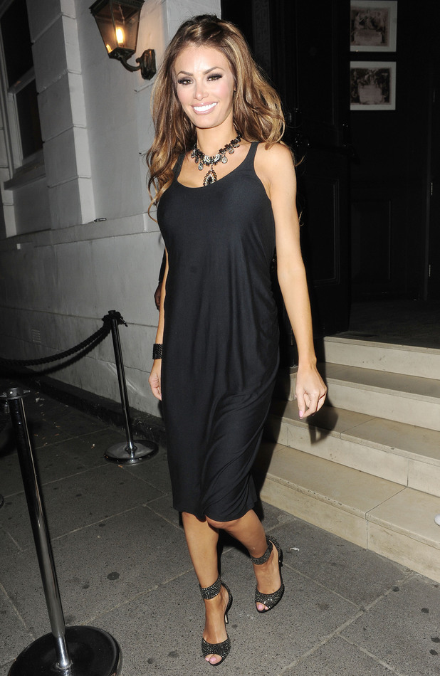 Chloe Sims in a loose-fitting black dress for a night at The Brompton Club, London, Friday 7 June 2013