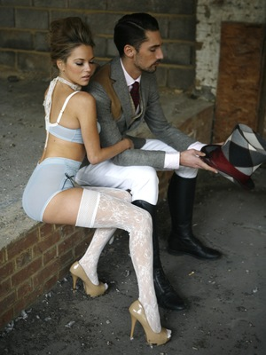 Natalie Joel modelling a powder blue bra and knickers from La Figurelle, with Hugo Taylor in the background
