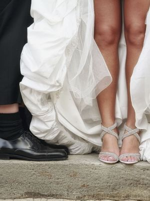 Bride and groom showing off their feet