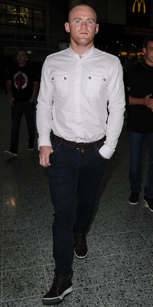 Wayne and Coleen Rooney arrive at the Rihanna concert in Manchester on their wedding anniversary. Wayne is sporting a crew cut after his second hair transplant. 12 June 2013