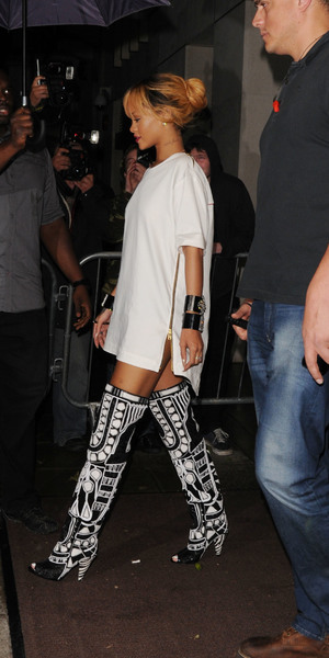 Rihanna arrives at Cuckoo club at 3.30 am holding an umbrella shielding herself from the heavy rain. Rihanna stayed until 5am as she partied the night away. JUNE 14 2013