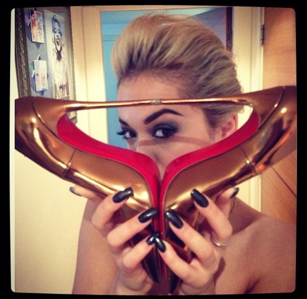 Rita Ora holds up gold heels to show off her black, Gelish manicure by Rebecca Wilson, Glamour Women of the Year Awards, 4 June 2013