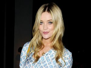 Laura Whitmore looks chic in printed blouse and cigarette trousers