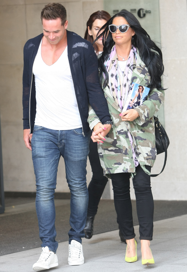 Kieran Hayler and Katie Price leave the BBC Radio 1 studios carrying a copy of her latest book 'He's The One'