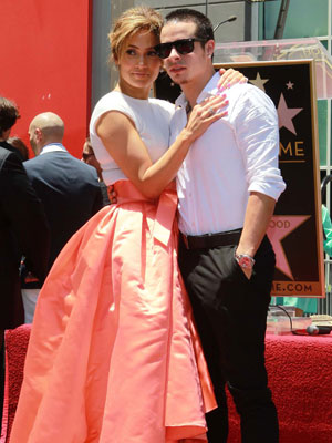 Jennifer Lopez poses with Casper Smart as she is honoured with the 2,500th star on the Hollywood Walk of Fame, 20 June 2013