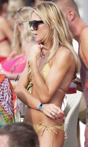 Abbey Clancy wears gold bikini at Ocean Beach in Ibiza - 24 June 2013