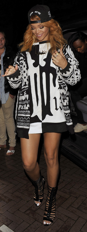 Rihanna arrives back at her hotel wearing a black and white jumper dress and London skyline necklace - Amsterdam, 24th June 2013