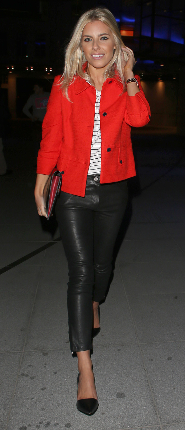 Mollie King wears a red jacket, striped top and black leather trousers as she leaves the BBC Radio 1 studios - London 23rd June 2013