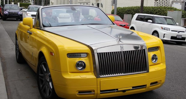 Scott Disick is seen leaving Barneys New York in Beverly Hills in yellow Rolls Royce after shopping with friends. 25 June 2013