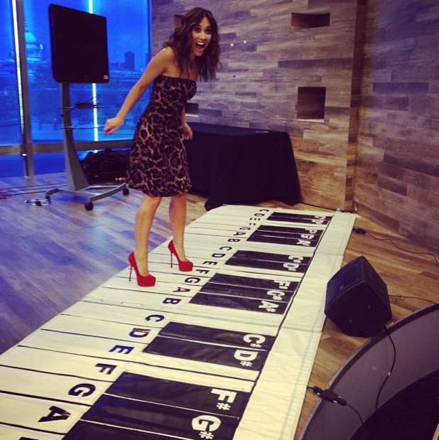 Myleene Klass tries out a giant piano with her feet - 25 June 2013