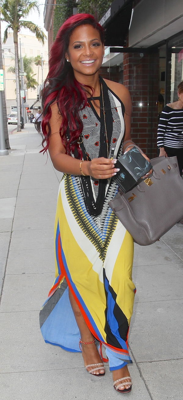 Christina Milian in Beverley Hills wearing a bold printed maxi dress in Beverly Hills, USA - 3 July 2013