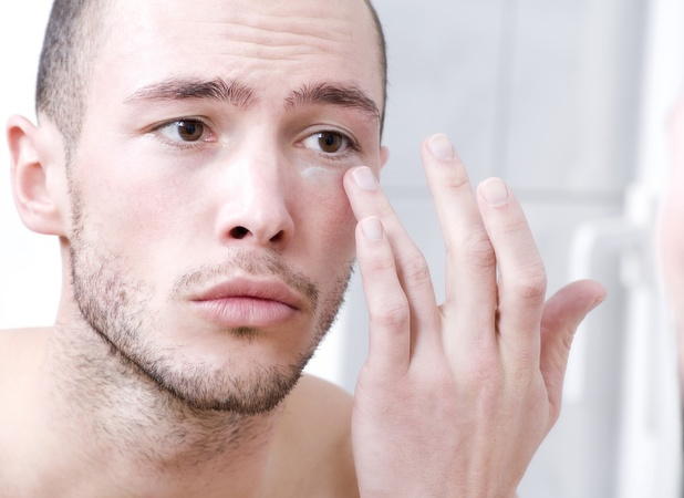 Man putting on face cream
