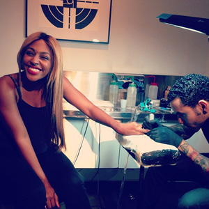 Alexandra Burke gets new tattoo at Bang Bang 2 July