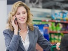 Is it rude to use your mobile phone at the till?